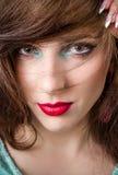 Il fronte grazioso di una donna bionda con compone Immagine Stock Libera da Diritti