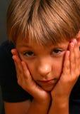 Il fronte in mani Fotografie Stock