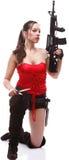 Il fucile della holding della ragazza islated su priorità bassa bianca Immagine Stock Libera da Diritti