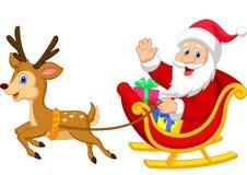 Il fumetto Santa guida la sua slitta Fotografie Stock Libere da Diritti