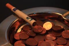 Il fumo è costoso Fotografie Stock Libere da Diritti