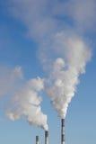 Il fumo dai camini Fotografia Stock