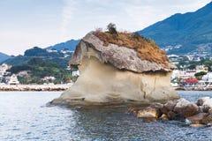 Il Fungo, famous coastal mushroom shaped rock. Lacco Ameno resort town, Ischia island, Italy Stock Photos