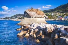 Il Fungo, famous rock in mushroom shape. Lacco Ameno resort town, Ischia island, Italy Stock Photos