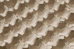Il fuoco selettivo sul vassoio del cartone per le uova, immagine astratta gradisce i precedenti di ripetizione Immagine Stock Libera da Diritti