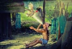 Il gallo da combattimento riscalda questo è stile di vita della gente in Asia, agricoltore rurale Immagine Stock