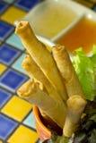 Il gamberetto fritto nel grasso bollente rotola sul mosaico Immagini Stock Libere da Diritti