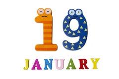 Il 19 gennaio, su un fondo bianco, sui numeri e sulle lettere Fotografia Stock