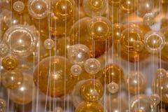 Il giallo bolle sfere di cristallo sospese in aria Fotografia Stock Libera da Diritti