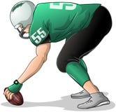 Il giocatore di football americano si inginocchia e tiene la vista laterale della palla Fotografia Stock