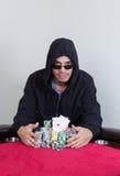 Il giocatore di poker sorride con gli assi della tasca Immagini Stock