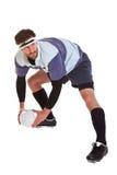 Il giocatore di rugby ha tagliato su bianco immagini stock