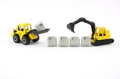 Il giocattolo dell'escavatore e del bulldozer fa la configurazione di parola Immagine Stock
