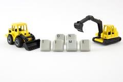 Il giocattolo dell'escavatore e del bulldozer fa la parola in tempo Fotografie Stock Libere da Diritti
