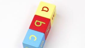Il giocattolo variopinto dell'alfabeto blocca l'ortografia della tornitura di ABC archivi video