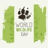 Il giorno della fauna selvatica del mondo - vector il manifesto con l'orma del lupo Immagine Stock