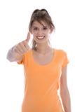 Il giovane adolescente femminile felice isolato ha passato l'esame. Fotografia Stock