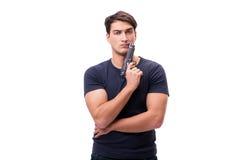 Il giovane aggressivo con la pistola isolata su bianco fotografie stock