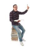 Il giovane allievo con i libri Immagine Stock