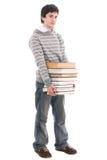 Il giovane allievo con i libri isolati su un bianco Immagini Stock Libere da Diritti