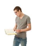 Il giovane allievo con il libro Immagine Stock