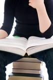 Il giovane allievo con il libro isolato Fotografie Stock