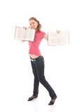 Il giovane allievo con libri isolati su un bianco Fotografie Stock
