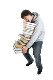 Il giovane allievo con un mucchio dei libri isolati Immagine Stock