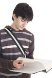 Il giovane allievo isolato su un bianco Fotografie Stock Libere da Diritti