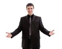 Il giovane, amichevole, un uomo in un vestito, accolto favorevolmente. Fotografia Stock