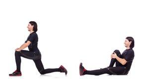 Il giovane che fa gli esercizi su bianco Fotografia Stock Libera da Diritti