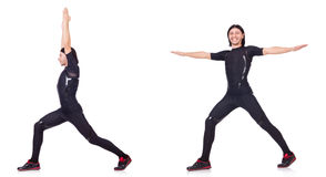 Il giovane che fa gli esercizi su bianco Immagine Stock Libera da Diritti