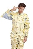 Il giovane coperto di note appiccicose gialle Immagine Stock Libera da Diritti