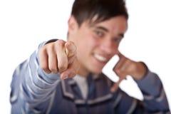 Il giovane ed adolescente piacevole indica con la barretta su voi Fotografia Stock Libera da Diritti
