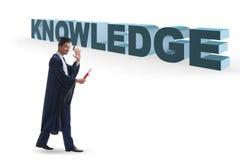 Il giovane laureato nel concetto di istruzione su bianco immagine stock libera da diritti