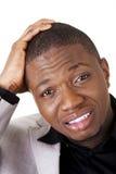 Il giovane nero ha disturbato l'uomo d'affari immagine stock libera da diritti