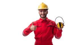 Il giovane operaio con rumore che annulla le cuffie su bianco Fotografia Stock