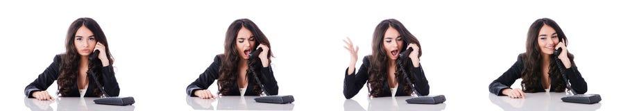 Il giovane operatore del telefono su bianco Immagini Stock Libere da Diritti