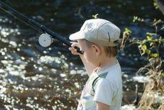 Il giovane pescatore Immagini Stock