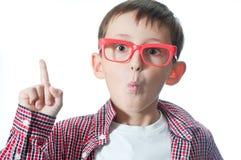 Il giovane ragazzo emozionante ha un'idea. Immagine Stock Libera da Diritti