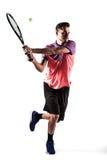 Il giovane sta giocando a tennis Fotografia Stock
