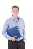 Il giovane sta tenendo un archivio sotto il suo braccio Fotografia Stock