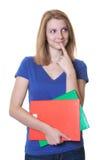 Il giovane studente con capelli ed i libri rossi ha un'idea Fotografie Stock
