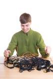 Il giovane tirante con i cavi isolati su un bianco Fotografia Stock