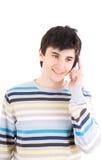 Il giovane tirante parla dal telefono Fotografie Stock