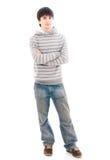 Il giovane tirante sorridente isolato su un bianco fotografia stock