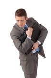 Il giovane uomo d'affari abbraccia un portafoglio con timore fotografia stock