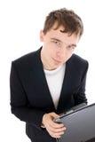 Il giovane uomo d'affari con il computer portatile isolato Fotografia Stock