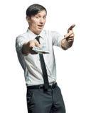 Il giovane uomo d'affari mostra un batuffolo di contanti disponibile Fotografia Stock Libera da Diritti