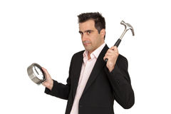 Il giovane uomo d'affari rompe l'orologio del suo spirito del lavoro Immagine Stock Libera da Diritti